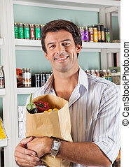 Man With Vegetable Bag In Grocery Store