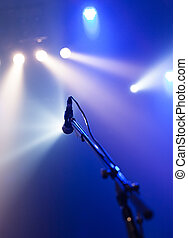 Microphone on empty stage waiting for a voice with copyspace...