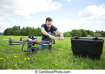 Technician Fixing Propeller Of UAV Helicopter - Young...