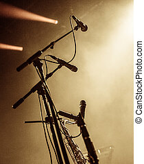 Set of microphones on stage with copyspace