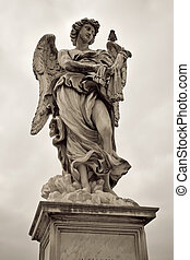 One of the angels at the Sant' Angelo bridge in Rome, Italy...