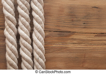 Ropes on a wooden background