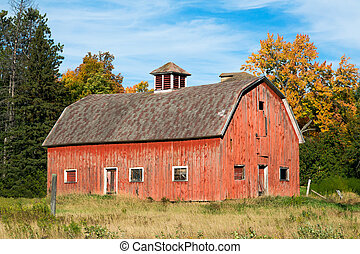 Old Red Barn in Wisconsin - An old faded red barn in rural...