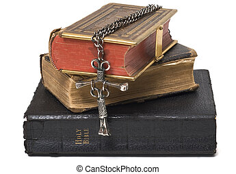 Antique Bibles and Cross - Three antique bibles with a nail...