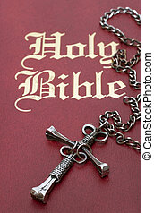 Nail Cross on Bible - Selective focus on the center of a...