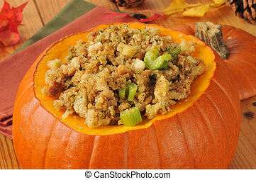 Cornbread stuffing with celery and turkey in a pumpkin