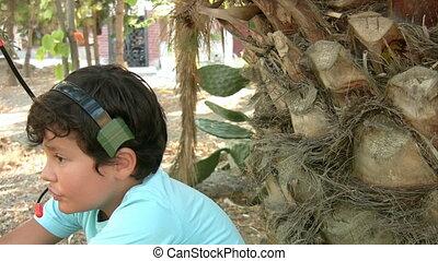 Little boy talking on his walkie ta