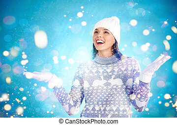 Winter joy - Joyful girl in winter wear enjoying snowfall