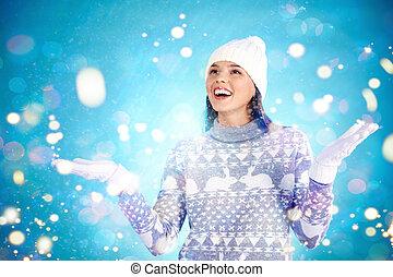 Winter joy - Joyful girl in winter wear enjoying snowfall