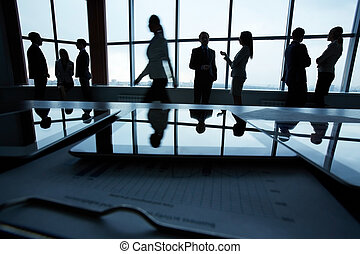 Business people in office - Silhouettes of several office...