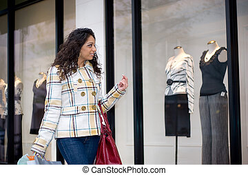 Window Shopping - An attractive girl out shopping in the...