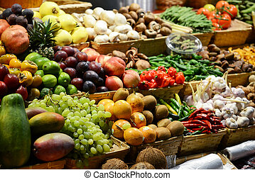 Fruit market with various colorful fresh fruits and...