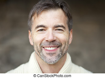 Portrait Of A Successful Adult Man Smiling At The Camera