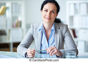 White collar worker - Smiling businesswoman in formalwear...