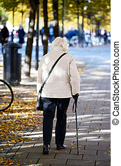 Old lady walking with stick