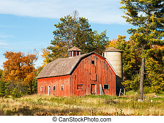 Old Red Barn and Silo - An old red barn with silo is...