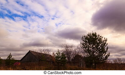 Clouds sweep over the barn Time Lapse 4K - Clouds sweep over...