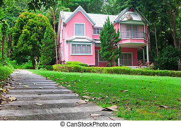 pink house in forest