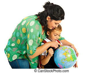 Mother showing to son on world globe - Mother showing...