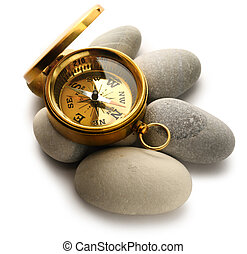 Compass and sea stones on white
