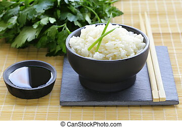 boiled white rice in a black bowl, Asian style