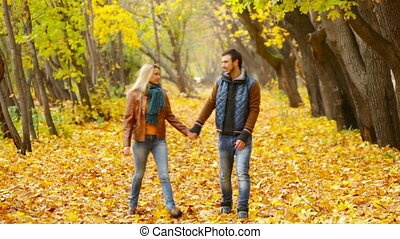 Carefree Autumn - Cheerful young couple enjoying their...