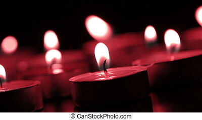Candles lights in a red tone