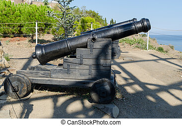 Old cannons near the Temple-beacon in Malorechenskoye Crimea...