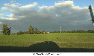 car shadow in motion on field