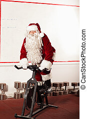 Santa Claus training on bike - Santa Claus training on...
