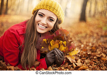 Happy gorgeous woman at autumn season