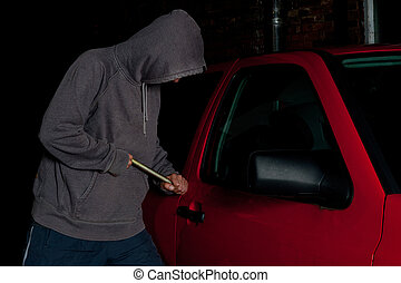 Car Break In - A man with a hooded pullover attempting to...