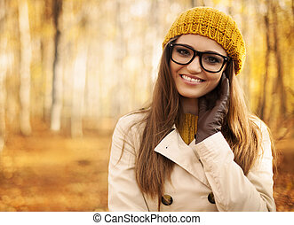 Portrait of beautiful woman at autumn