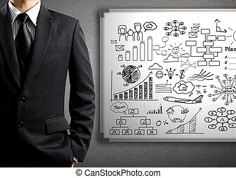 Business man and white board - Business man standing in...