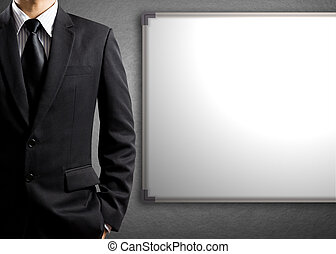 Business man and blank white board