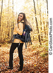 Portrait of beautiful and smiling hiker with backpack