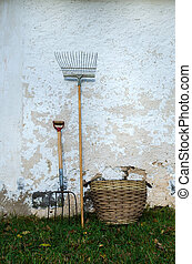 Old Garden Tools - Old garden tools at a weathered wall.