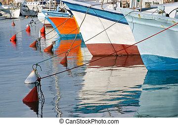 Fishing boats in Old Jaffa, Israel. - Boats moored on a...