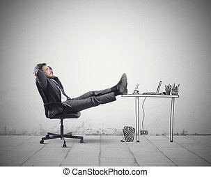 Relax in office - Successful businessman relaxing in an...