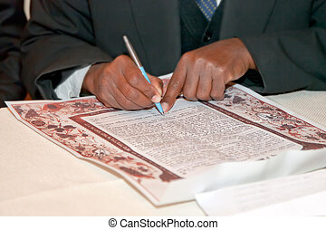 Traditional jewish wedding, signing prenuptial agreement...