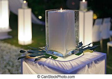 A wedding reception decorated with candles and plants