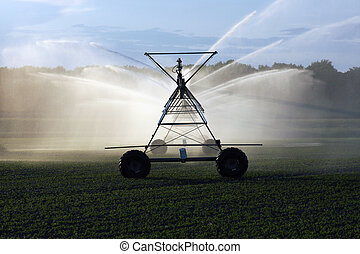 irrigation system - water spraying over a field from an...