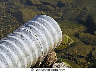 Drain Pipe - Large metal drain pipe going out into the lake