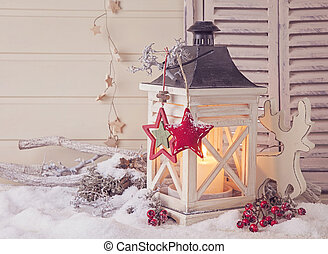 Burning lantern and christmas decoration on white background