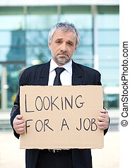 Looking for a job Depressed senior man in formalwear holding...