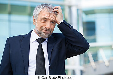 Frustrated businessman Depressed senior man in formalwear...