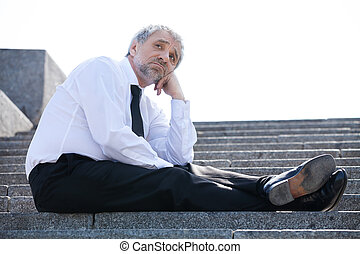 Depressed businessman Sad senior man in formalwear sitting...