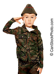 saluting - Portrait of a boy dressed like a soldier....