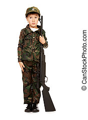 patriotism - A boy dressed like a soldier standing with a...