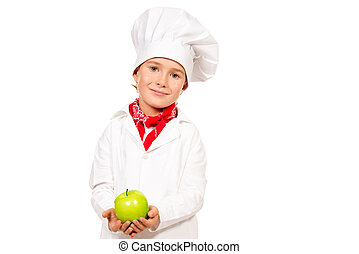 nutrition - Little boy cook holding green apple Different...